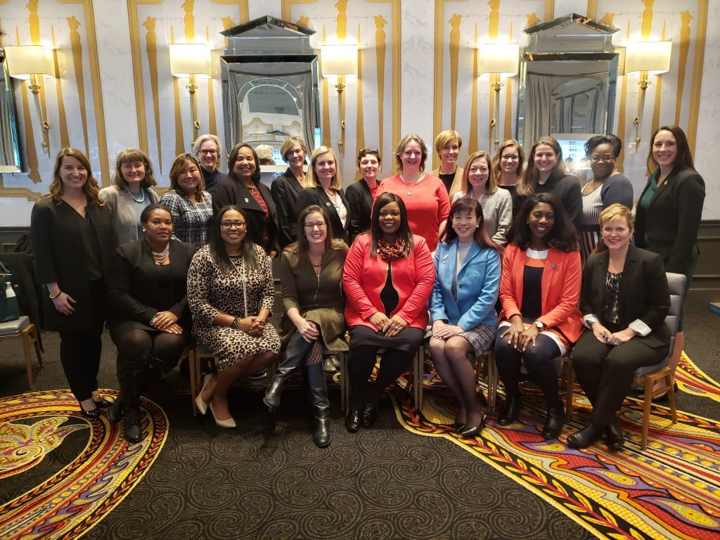 Group of over 20 women mayors sitting and smiling