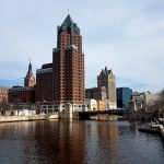 River with buildings in background in Milwaukee, WI