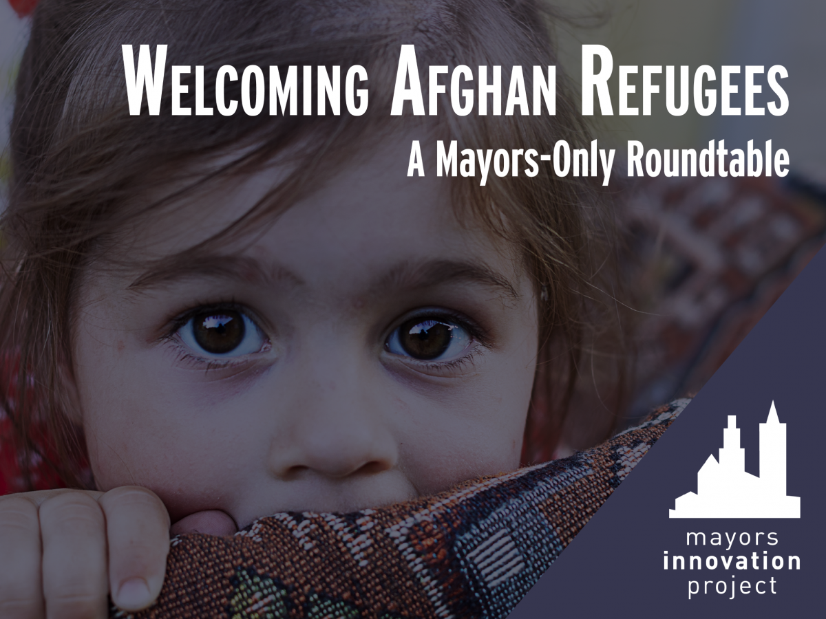 Little girl looking at camera. Text reads'Welcoming Refugees, a mayors-only roundtable'